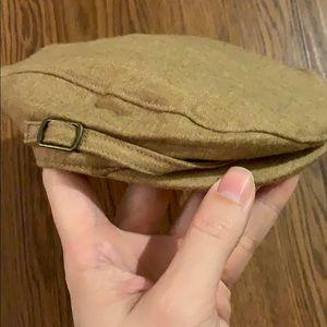 Tweed newsboy hat.